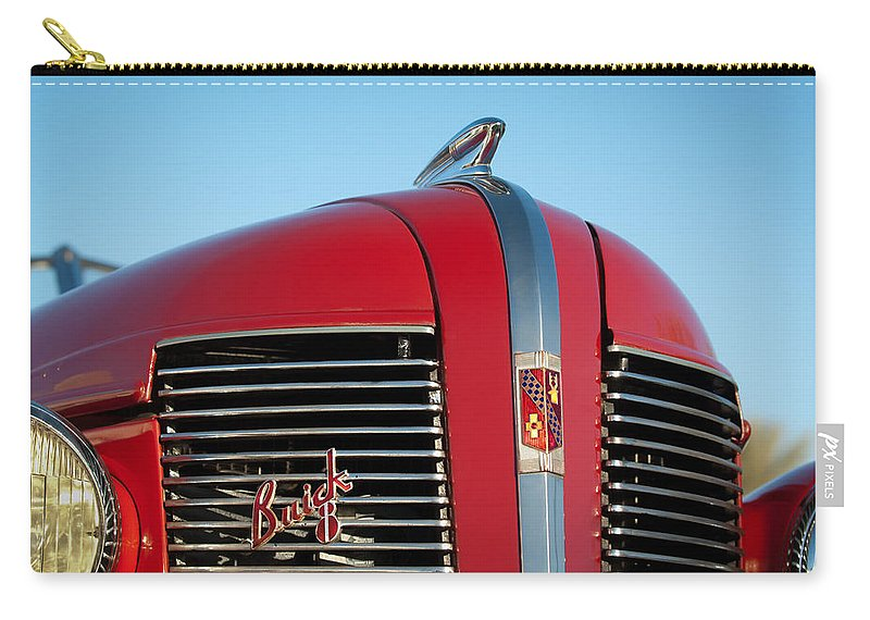 1937 Buick Boattail Roadster Grille Emblems Carry-all Pouch featuring the photograph 1937 Buick Boattail Roadster Grille Emblems by Jill Reger