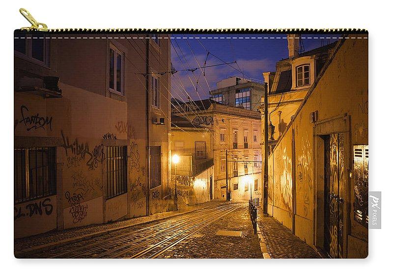 Lisbon Carry-all Pouch featuring the photograph Calcada Da Gloria Street At Night In Lisbon by Artur Bogacki
