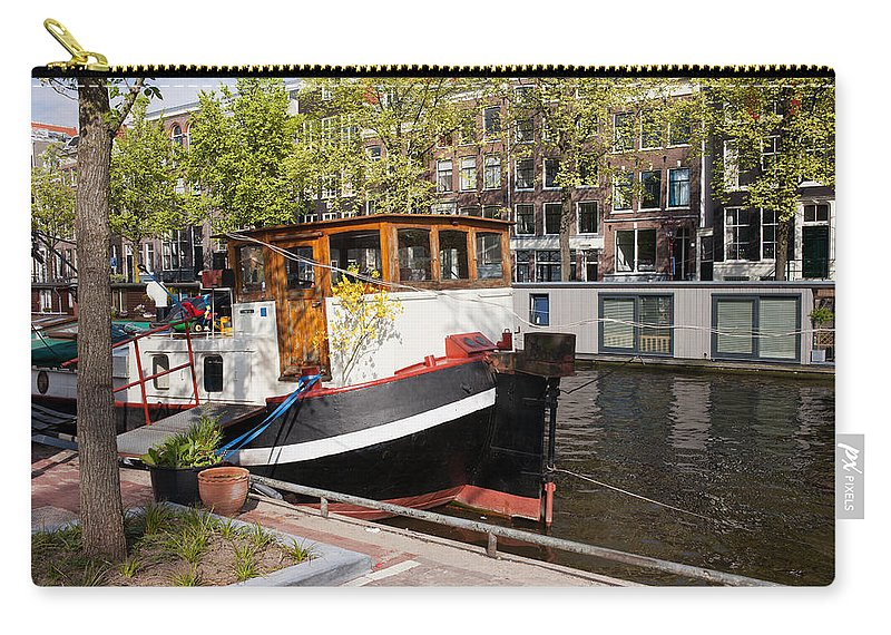Amsterdam Carry-all Pouch featuring the photograph Canal In The City Of Amsterdam by Artur Bogacki