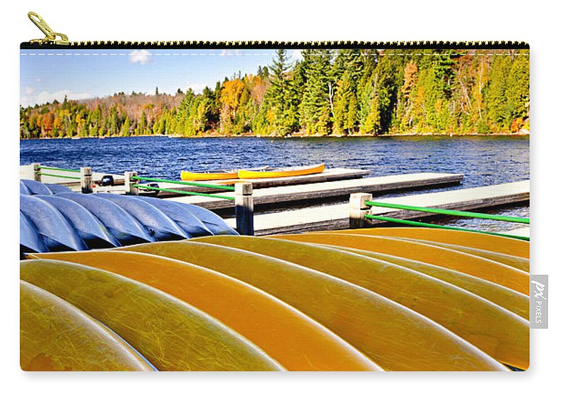 Canoes Carry-all Pouch featuring the photograph Canoes On Autumn Lake by Elena Elisseeva