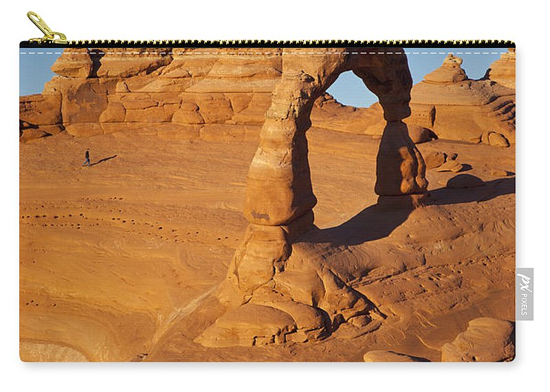 America Carry-all Pouch featuring the photograph Delicate Arch At Sunset by Brian Jannsen