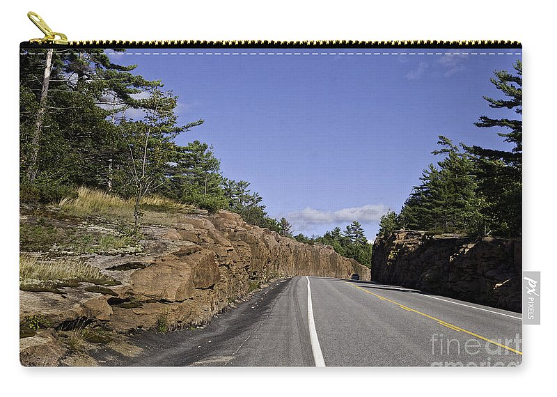 Rock Carry-all Pouch featuring the photograph Driving Through A Rock Cut by Les Palenik