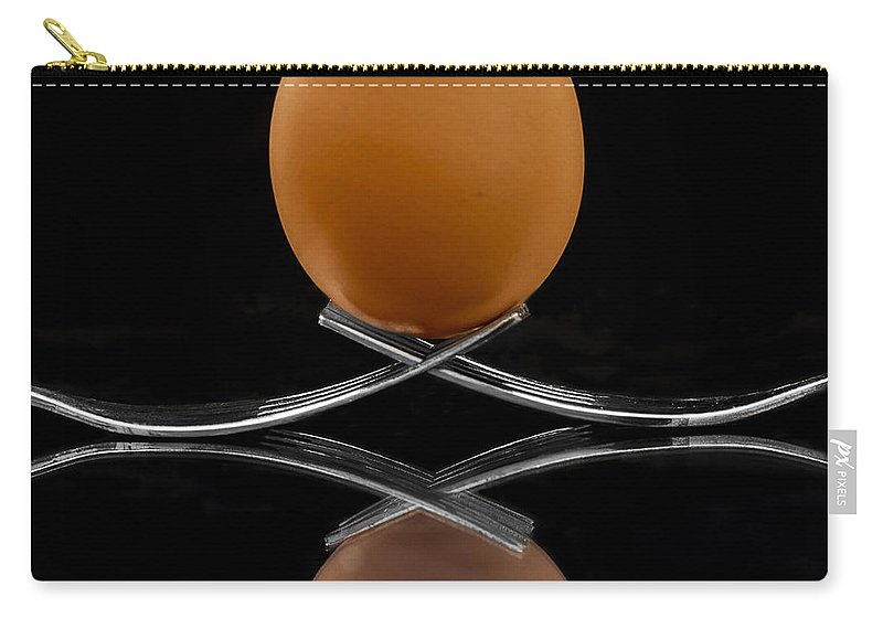Fork Carry-all Pouch featuring the photograph Egg On Top Of Forks by Paulo Goncalves