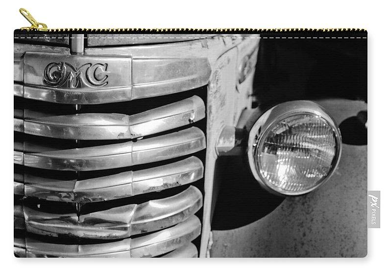 Gmc Truck Grille Emblem Carry-all Pouch featuring the photograph Gmc Truck Grille Emblem by Jill Reger