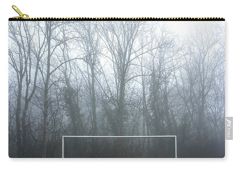 Abandoned Carry-all Pouch featuring the photograph Goal by Bernard Jaubert