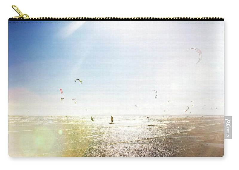 Water's Edge Carry-all Pouch featuring the photograph Kite Surfers by Nick David