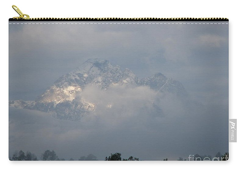 Rocky Mountains Carry-all Pouch featuring the photograph Out Of The Clouds by Greg Patzer