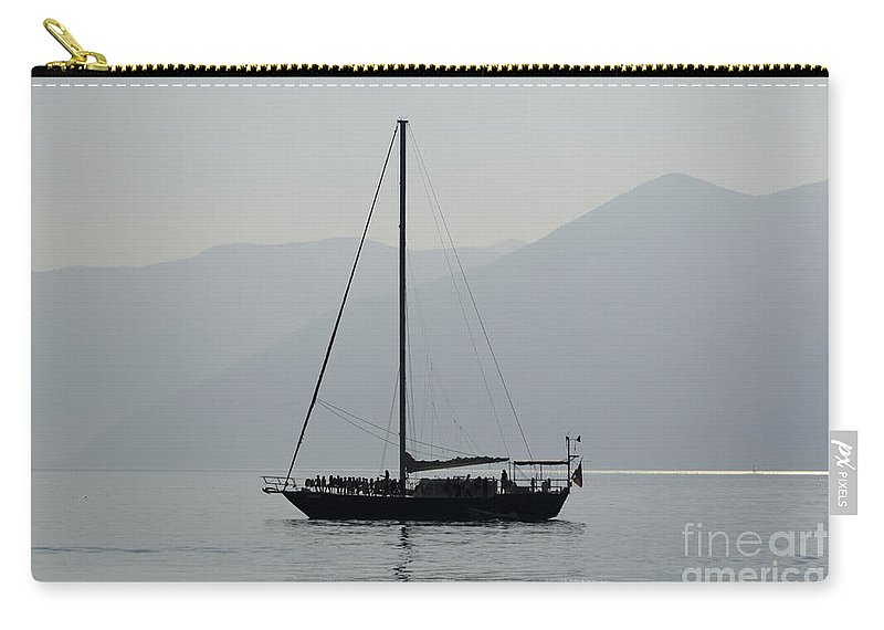 Sailing Boat Carry-all Pouch featuring the photograph Sailing Boat And Mountain by Mats Silvan