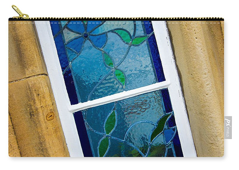 Blue Carry-all Pouch featuring the photograph Stained Glass Window by Mark Llewellyn
