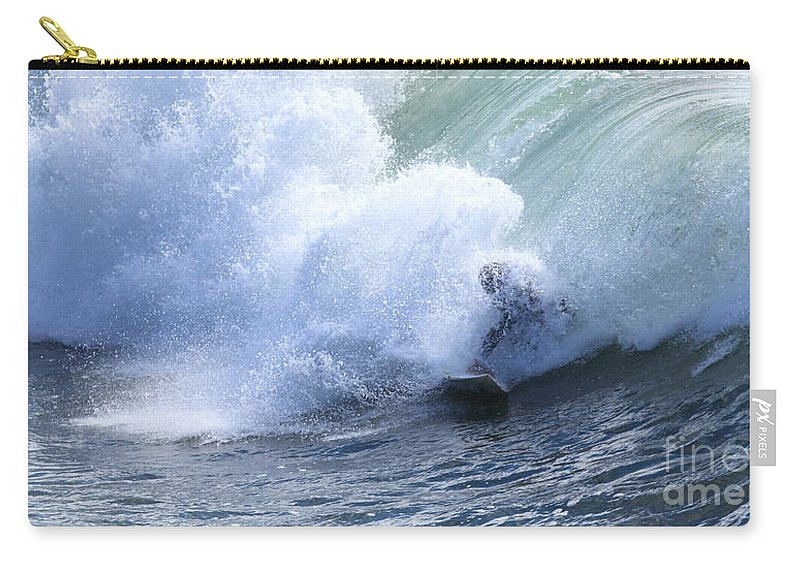 Surfing Carry-all Pouch featuring the photograph Surfer by Henrik Lehnerer