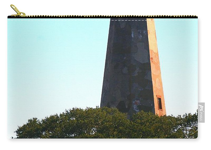 Lighthouse Carry-all Pouch featuring the photograph The Lighthouse by Nadine Rippelmeyer