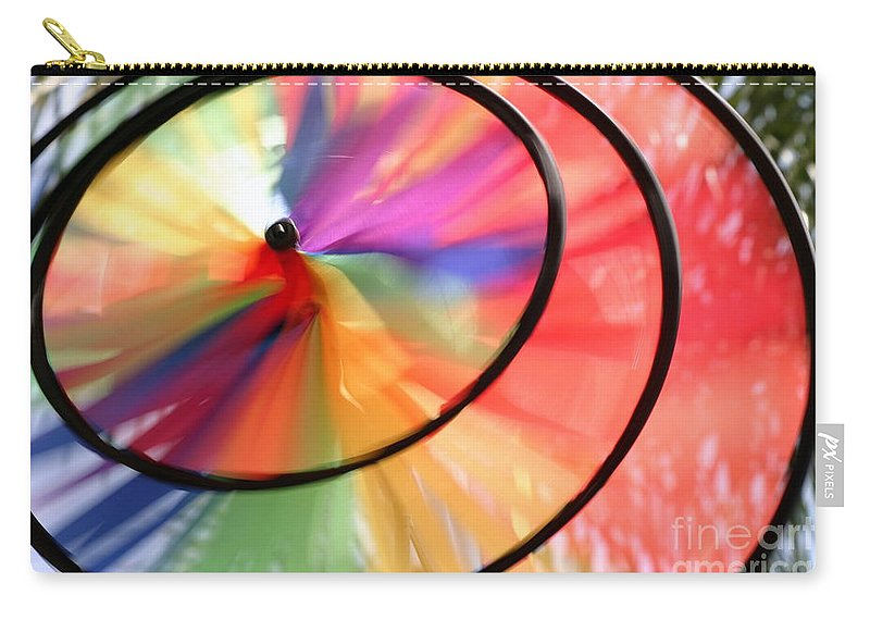 Blowing Carry-all Pouch featuring the photograph Wind Wheel by Henrik Lehnerer