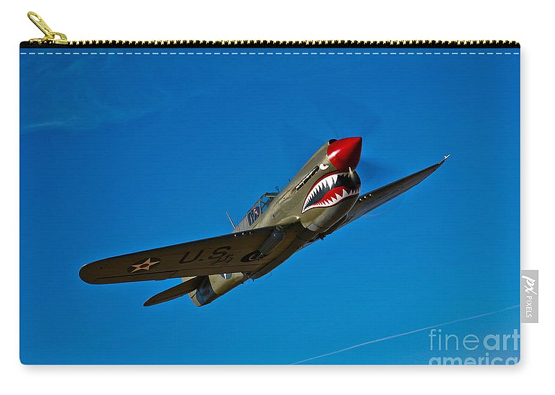 Horizontal Carry-all Pouch featuring the photograph A Curtiss P-40e Warhawk In Flight by Scott Germain