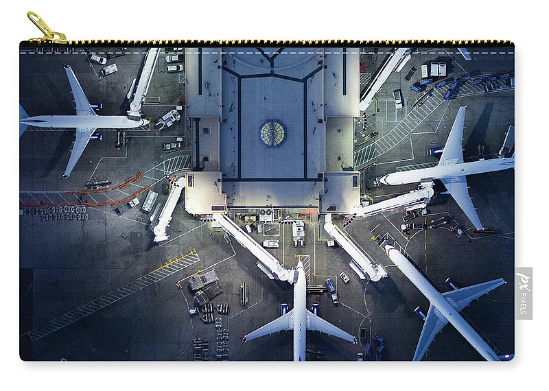 Airport Terminal Carry-all Pouch featuring the photograph Airliners At Gates And Control Tower by Michael H
