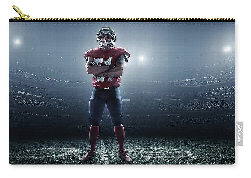 Soccer Uniform Carry-all Pouch featuring the photograph American Football In Action by Dmytro Aksonov