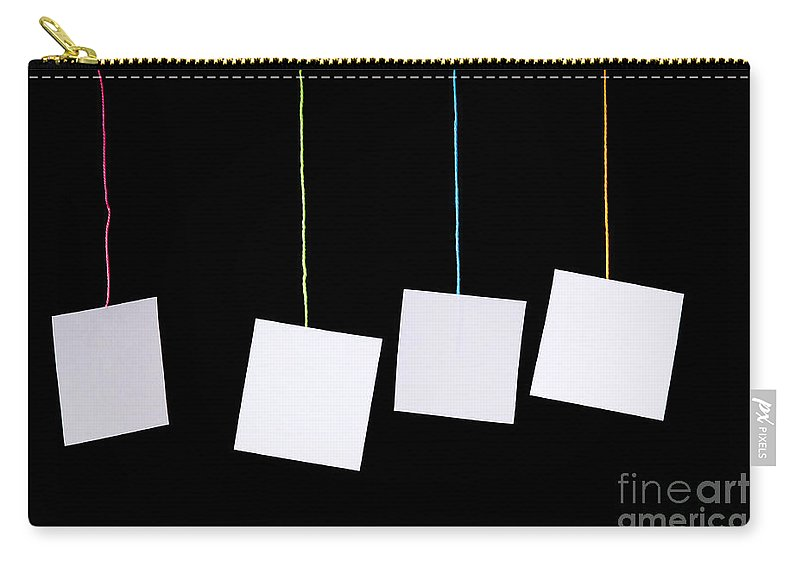 Advertisement Carry-all Pouch featuring the photograph Hanging White Tags by Tim Hester
