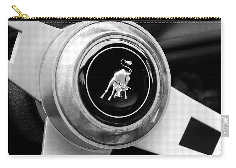 Lamborghini Steering Wheel Emblem Carry-all Pouch featuring the photograph Lamborghini Steering Wheel Emblem by Jill Reger