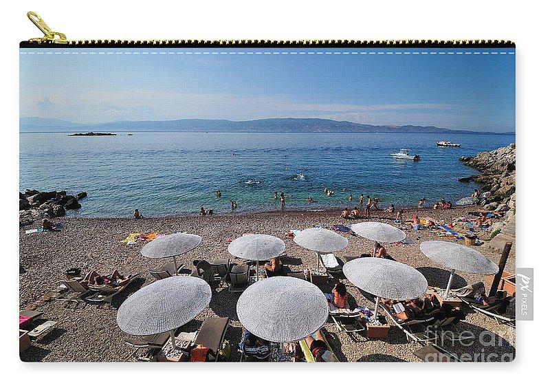 Hydra; Idra; Kaminia; Kamini; Mikro Kamini; Greece; Island; Hellas; Greek; Hellenic; Argosaronic; Saronic; Gulf; Islands; Beach; People; Tourists; Swim; Swimming; Sunbathing; Suntanning; Suntan; Tanning; Holidays; Vacation; Travel; Trip; Voyage; Journey; Tourism; Touristic; Summer; Sunny; Sea; Umbrellas; Parasols; Sunshades; Sea Beds; Sun Beds; Blue Carry-all Pouch featuring the photograph Mikro Kamini Beach by George Atsametakis