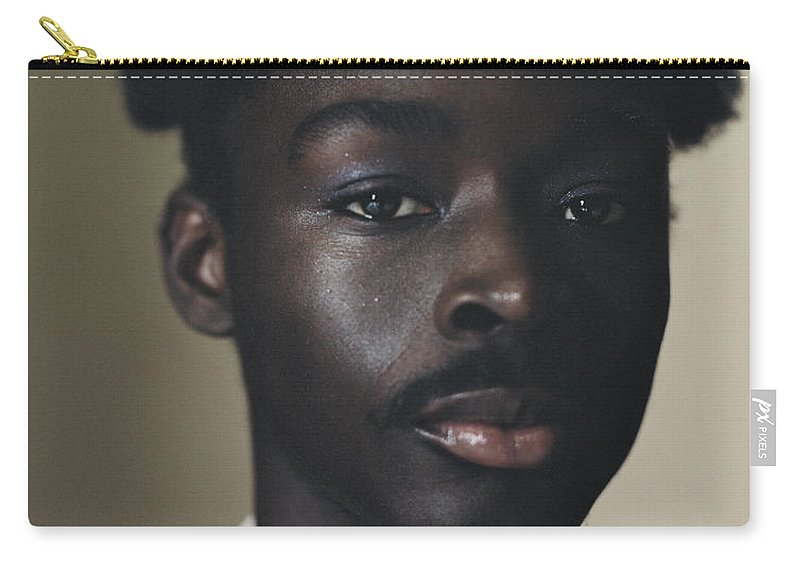 Handsome People Carry-all Pouch featuring the photograph Portrait Of Young Person Holding by Campbell Addy