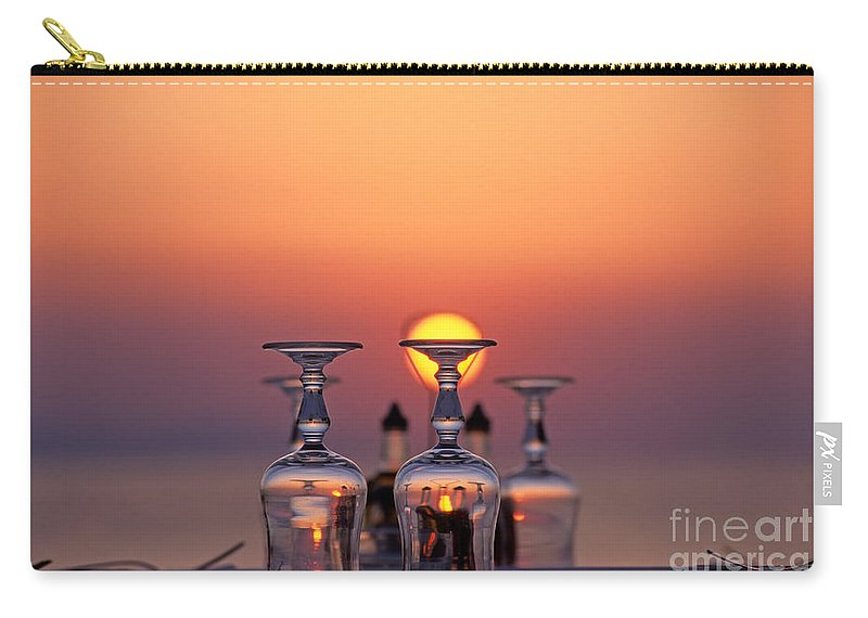 Mykonos; Mikonos; Town; City; Chora; Hora; Little Venice; Greece; Hellas; Cyclades; Kyklades; Greek; Hellenic; Aegean; Island; Sun; Red; Sky; Pink; Restaurant; Tavern; Sunset; Sundown; Islands; Table; Glasses; Reflection; Reflections; Holidays; Vacation; Travel; Trip; Voyage; Journey; Tourism; Touristic; Summer Carry-all Pouch featuring the photograph Sunset Behind A Restaurant by George Atsametakis