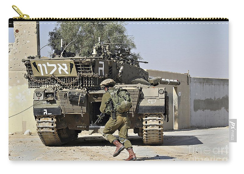 Battletank Carry-all Pouch featuring the photograph An Israel Defense Force Merkava Mark II by Ofer Zidon