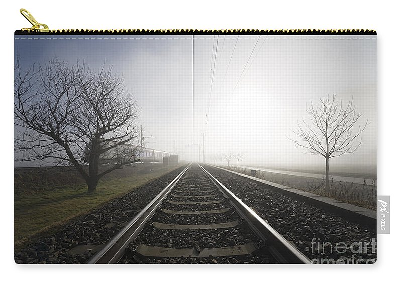 Railroad Tracks Carry-all Pouch featuring the photograph Railroad Tracks by Mats Silvan