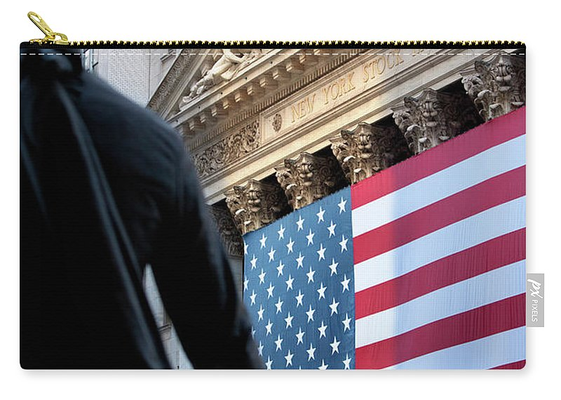 American Carry-all Pouch featuring the photograph Wall Street Flag by Brian Jannsen