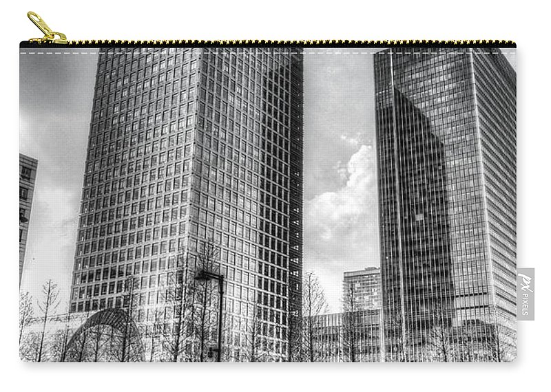 Taxi Taxis Carry-all Pouch featuring the photograph Canary Wharf London by David Pyatt