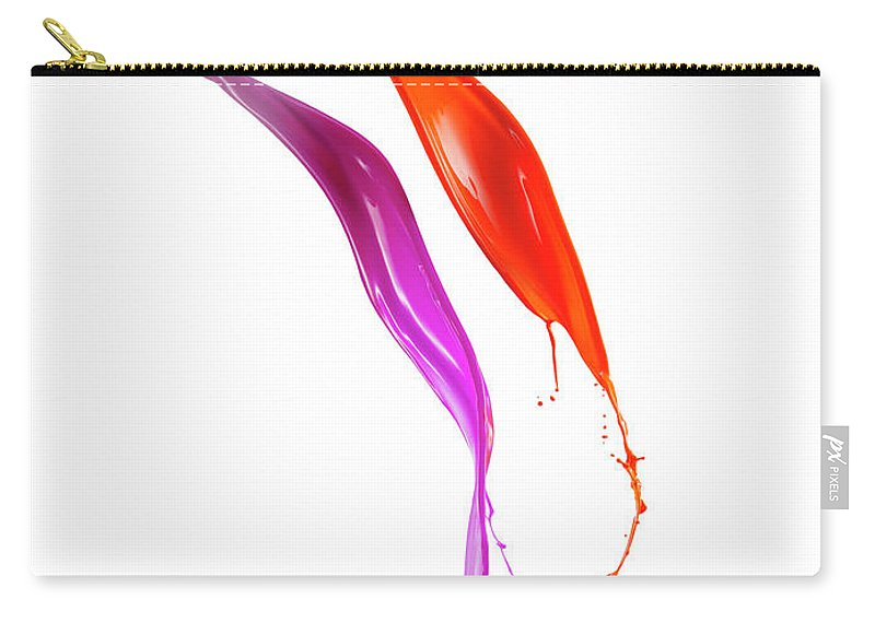 Orange Color Carry-all Pouch featuring the photograph Splashing Of The Color Paint by Level1studio
