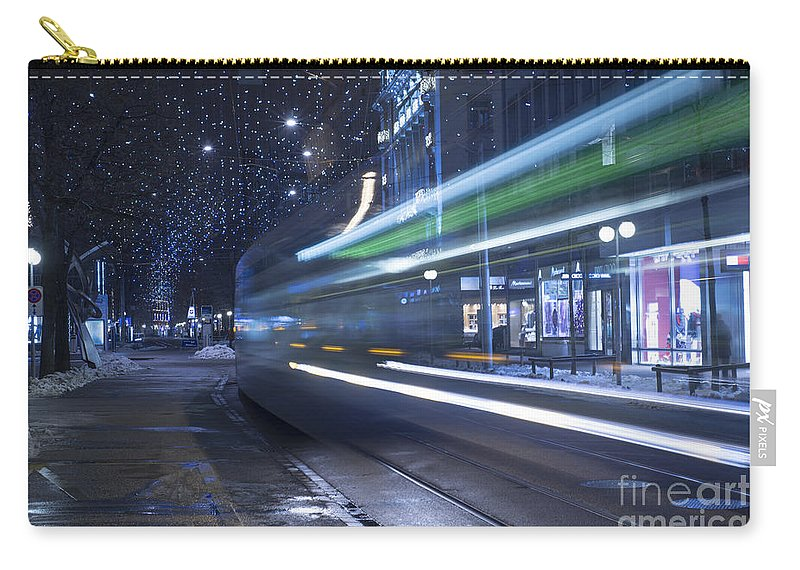 Tram Carry-all Pouch featuring the photograph Tram At Night by Mats Silvan