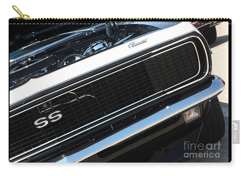 1967 Carry-all Pouch featuring the photograph 67 Black Camaro Ss Grill-8039-2 by Gary Gingrich Galleries