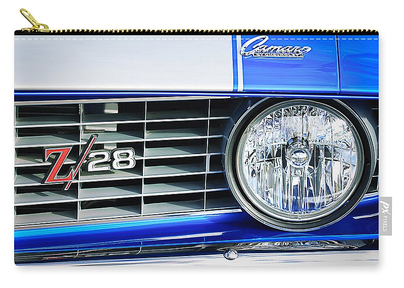 1969 Chevrolet Camaro Z-28 Grille Emblem Carry-all Pouch featuring the photograph 1969 Chevrolet Camaro Z-28 Grille Emblem by Jill Reger