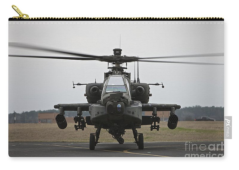 Aircraft Carry-all Pouch featuring the photograph Ah-64 Apache Helicopter On The Runway by Terry Moore