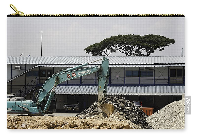Action Carry-all Pouch featuring the photograph A Bulldozer Moving Dug Out Concrete And Fresh Earth Below The Concrete by Ashish Agarwal