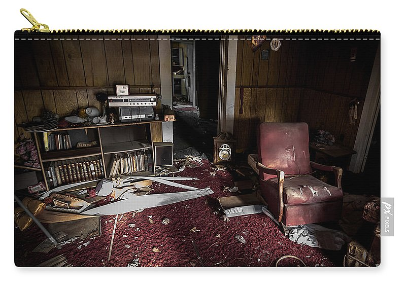 Abandoned Carry-all Pouch featuring the photograph A Chair In Red by Ken Frischkorn