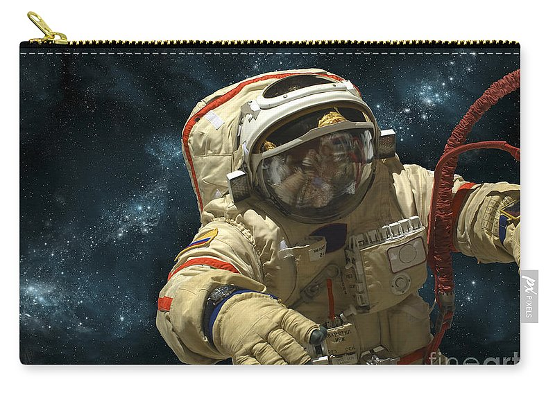 Astronaut Carry-all Pouch featuring the photograph A Cosmonaut Against A Background by Marc Ward