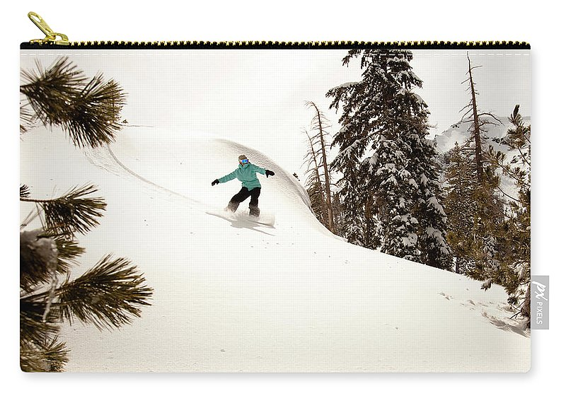 California Carry-all Pouch featuring the photograph A Female Snowboarder Lays Out Some by Kyle Sparks