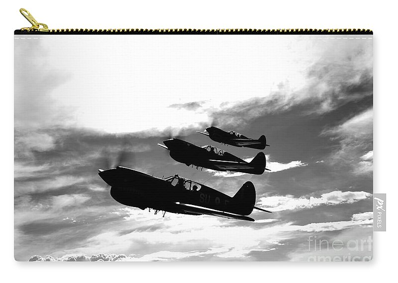 Horizontal Carry-all Pouch featuring the photograph A Group Of P-40 Warhawks Fly by Scott Germain