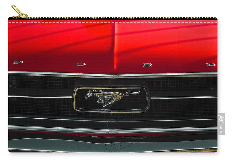 Ford; Mustang; Red; Black; Grey; Emblem; Logo; Grill; Bonnet; Hood; Chrome; Shiny Carry-all Pouch featuring the photograph A Mustang by Steve Taylor