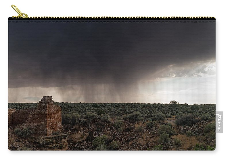 Ancestral Puebloans Carry-all Pouch featuring the photograph A Navajo 'male' Rain by Charlie Choc