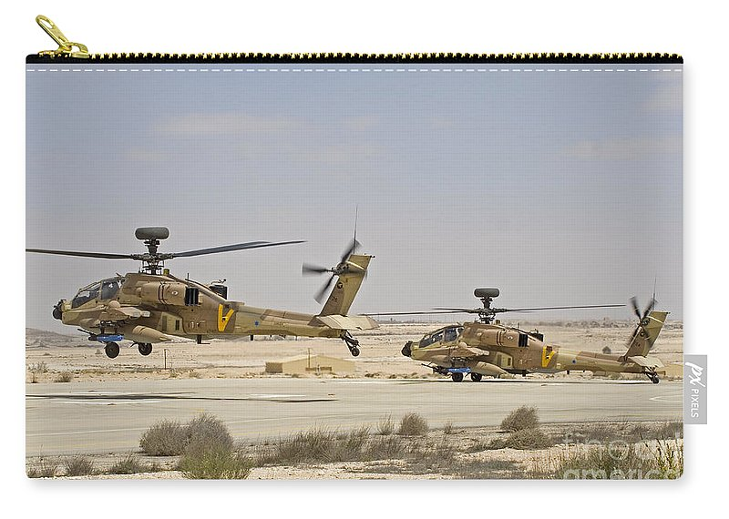 Transportation Carry-all Pouch featuring the photograph A Pair Of Ah-64d Saraf Attack by Ofer Zidon