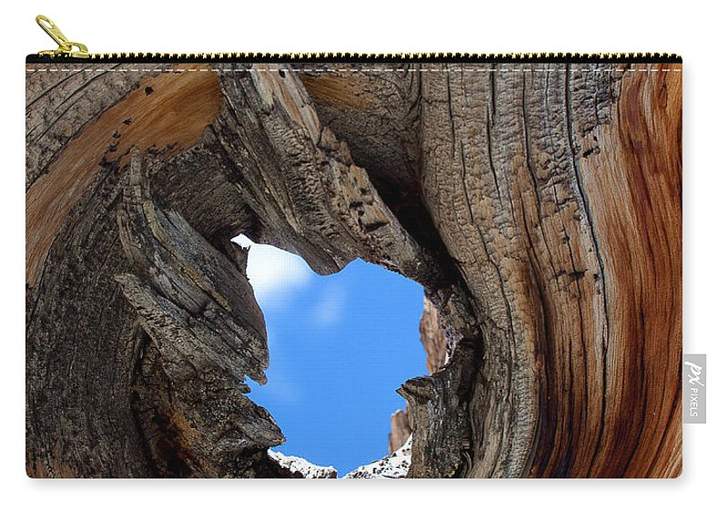 Blue Sky Print Carry-all Pouch featuring the photograph A Patch Of Blue by Jim Garrison