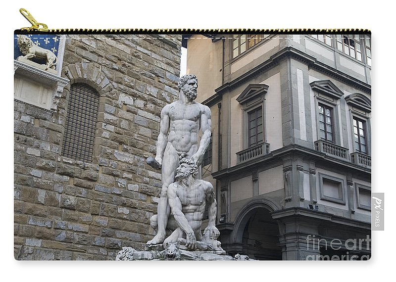 Travel Carry-all Pouch featuring the photograph A Replica Of Donatello's Marzocco by Jason O Watson