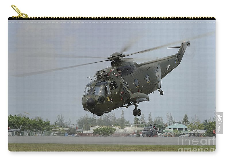 Horizontal Carry-all Pouch featuring the photograph A Sikorsky S-61a4 Helicopter by Remo Guidi