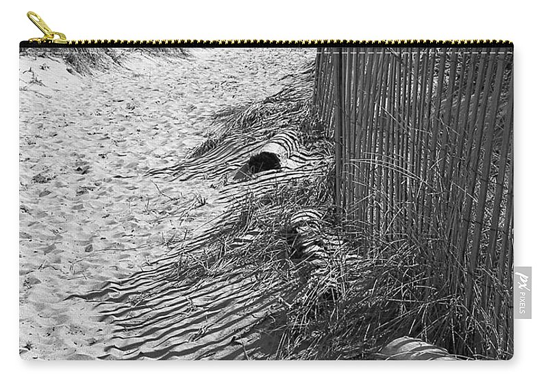 Beach Retaining Fence Carry-all Pouch featuring the photograph A Stroll In The Sand by Jeff Folger