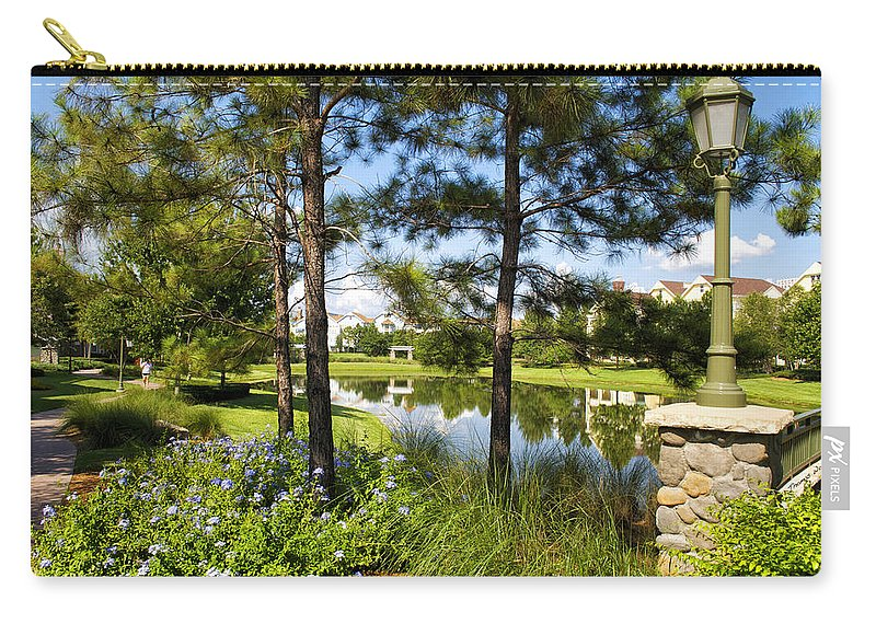 Pond Carry-all Pouch featuring the photograph A Tranquil Pond At Walt Disney World by Thomas Woolworth