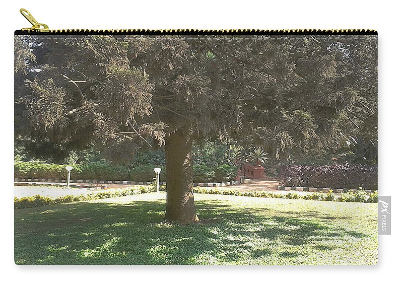 Tree Carry-all Pouch featuring the photograph A Tree by Artist Nandika Dutt
