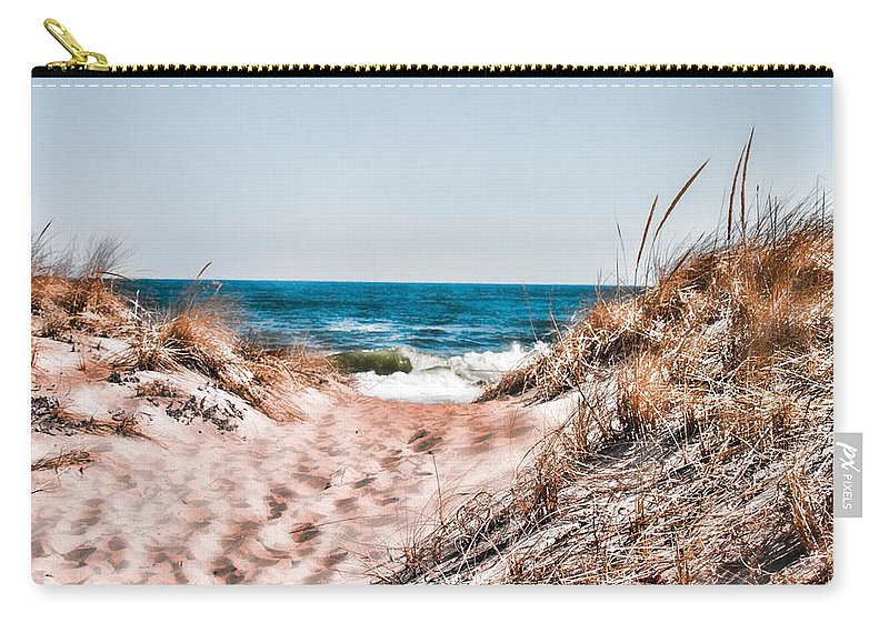 Beach Retaining Fence Carry-all Pouch featuring the photograph A Walk Out To The Water by Jeff Folger