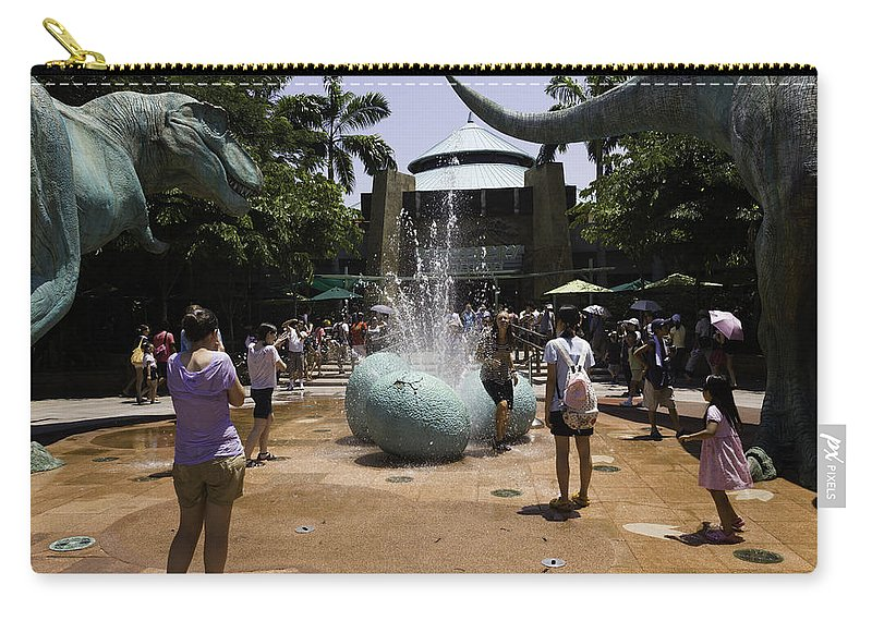 Asia Carry-all Pouch featuring the photograph A Water Fountain With Dinosaur Eggs In Universal Studios Singapore by Ashish Agarwal