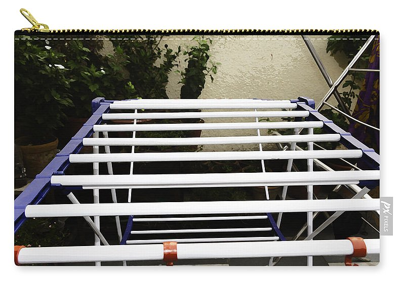 Aluminium Stand Carry-all Pouch featuring the photograph A White Plastic Stand For Hanging And Drying Clothes by Ashish Agarwal
